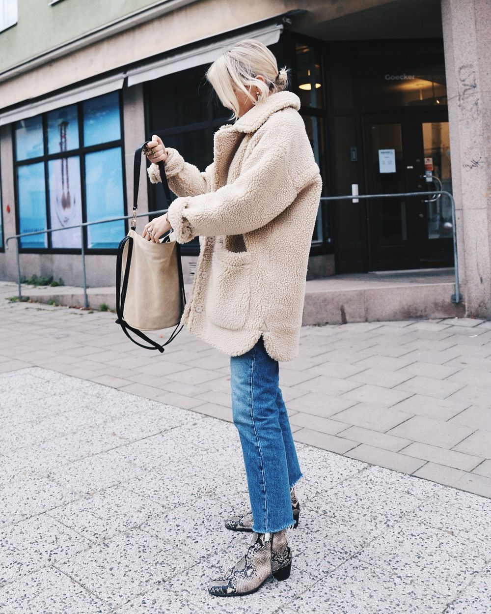 Get This Swedish Blogger's Cool Sherpa Jacket Outfit — Josefin Dahlberg in shearling jacket Jeans and Snake-Print Boots