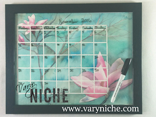 Vary Niche Fine Art Whiteboard Calendar with magnolias on a marbled turquoise background.