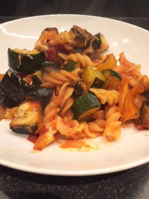 a portion of Mediterranean Vegetable pasta bake in a white bowl