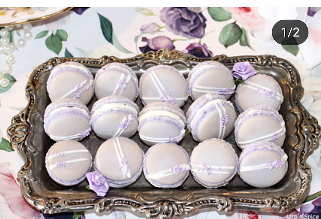 Pretty purple macarons sitting on a silver tray
