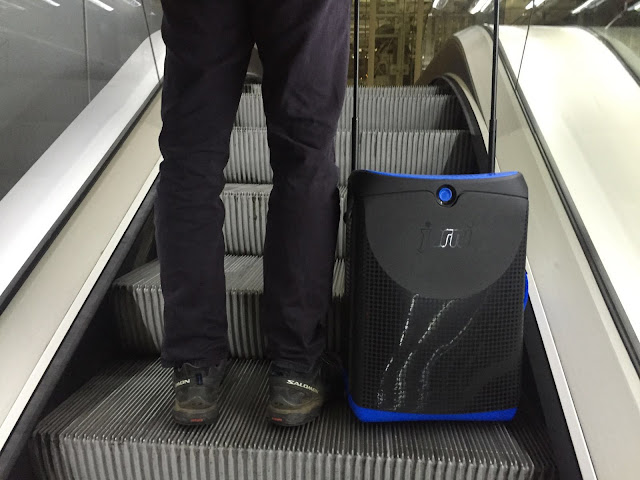 The blue Jurni case on the escalator to departures - #MyJurni