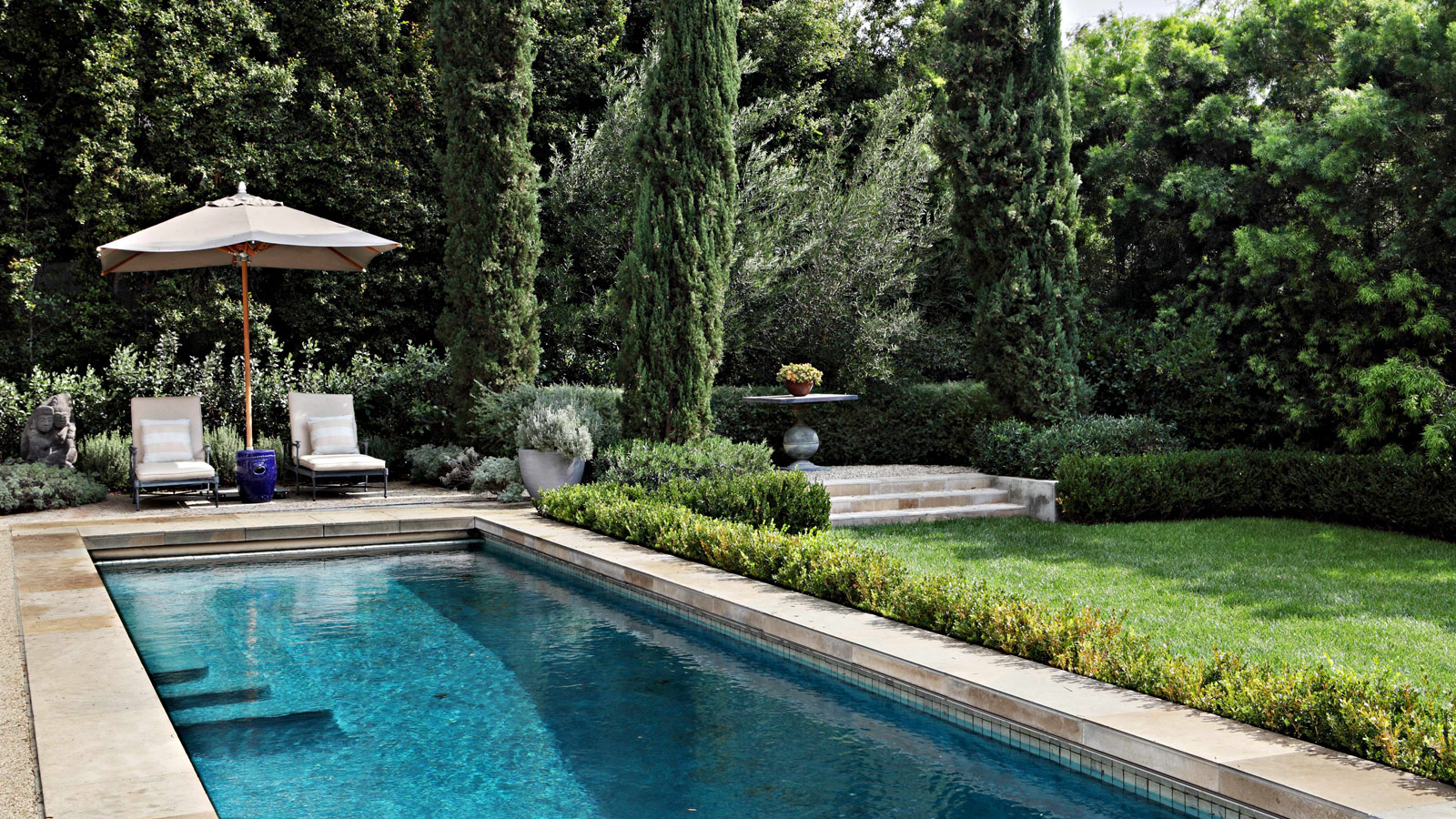 Enchanting pool and backyard gardens at William Hefner's LA home with Provence style. #pool #backyard #Provencestyle #Frenchinspired #garden