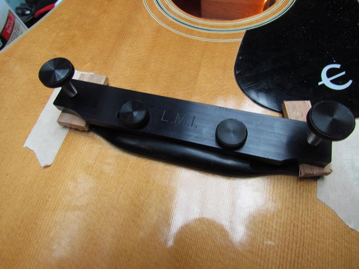 using fox bridge clamp to glue new bridge on an acoustic guitar crawls backward when alarmed. Black Bedroom Furniture Sets. Home Design Ideas