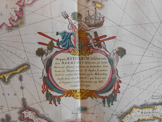 detail of Bermuda map cartouche shown Neptune holding his trident and an ship over a verbal description of the map.
