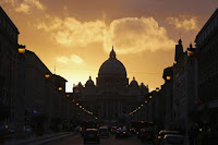 Saint Peter's Basilica at the Vatican is silhouetted during sunset in Rome, March 11, 2013. Roman Catholic Cardinals will begin their conclave inside the Vatican's Sistine Chapel Tuesday to elect a new pope. (Credit: Reuters/Paul Hanna) Click to Enlarge.