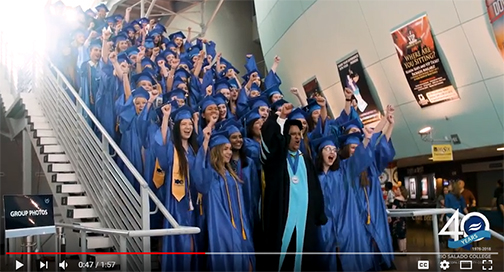 Snapshot from video of grads cheering with Rio Salado President Chris Bustamante