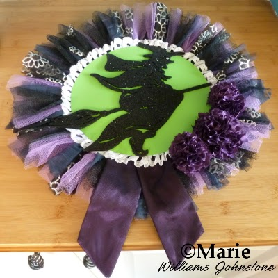 Black and purple Halloween witch wreath made with tulle and pom poms
