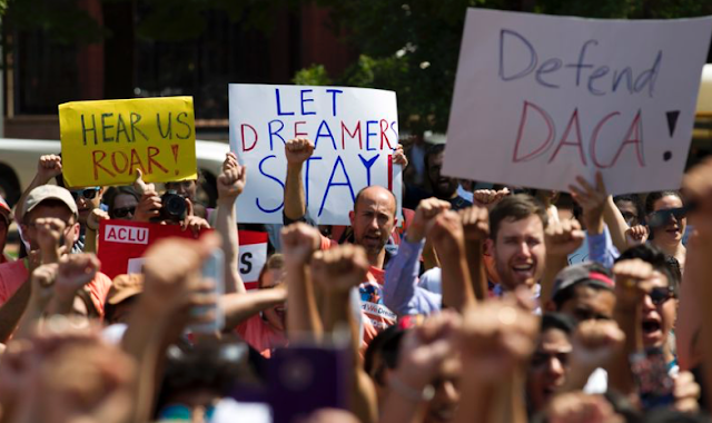 Federal judge orders complete restart of DACA