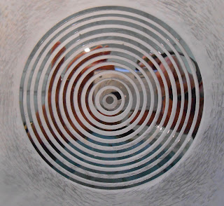 Close up of a page from Fragments of Light showing cut circles of silver mylar