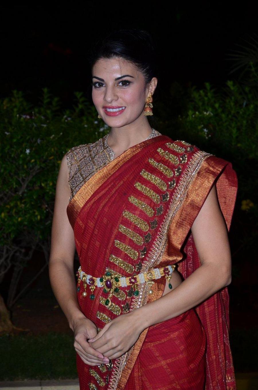 Jacqueline Hot Photos At Wedding Reception In Maroon Saree