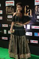 Ritika Singh in a Ethnic Deep Neck Dark Green Choli Ghagra at IIFA Utsavam Awards March 2017 ~ 050.JPG