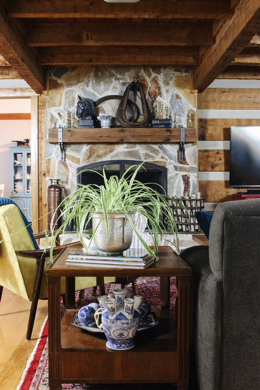 log-home-stone-fireplace-rustic-reclaimed-beam-mantel-styling-blue-white