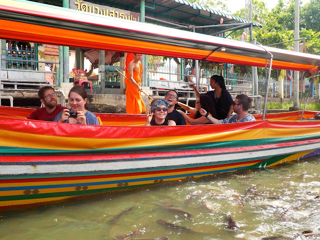 Cruising in a long tail boat around the canals of Bangkok, Thailand