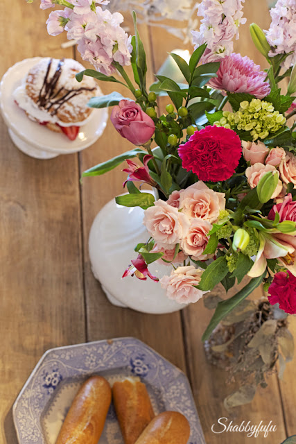 tablescape design tips - bright in seasons flowers and coordinating china will pull the whole tablescape together