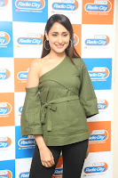 Pragya Jaiswal in a single Sleeves Off Shoulder Green Top Black Leggings promoting JJN Movie at Radio City 10.08.2017 120.JPG