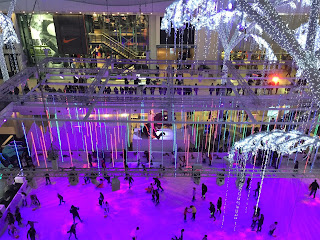 Pic of ice rink in purple light taken from top floor