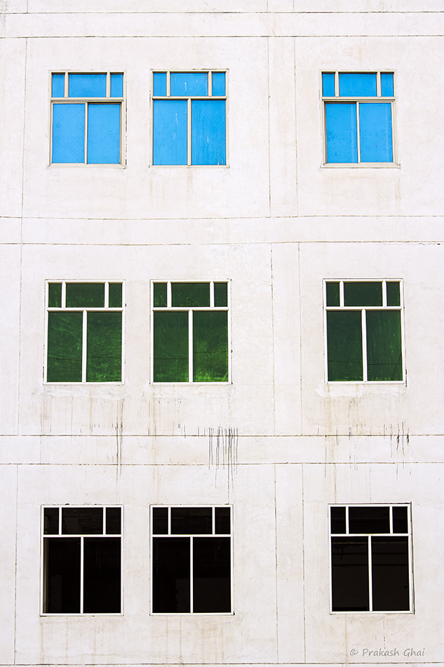 A Minimalist Photo of Multi Colored windows in repetition.