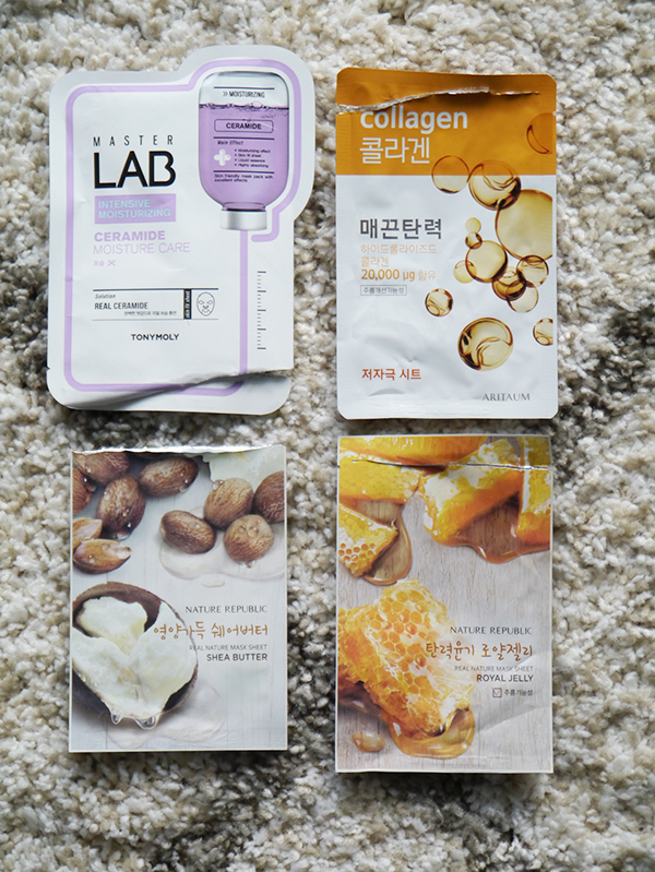 Round-up of empty sheet mask packets featuring TONYMOLY, Aritaum, Nature Republic