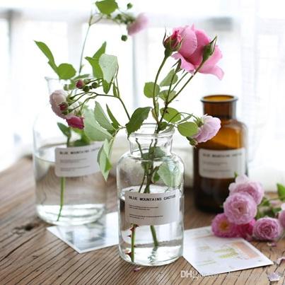 Botol kaca jadi vas bunga bergaya nordic/retro