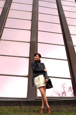 Grey moto jacket and cream mini skirt