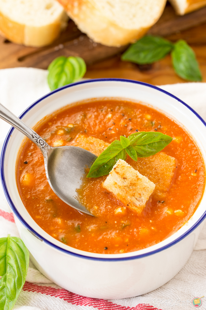 Fresh tomato basil soup is kicked up a notch with feta cheese. Easy to make, this easy homemade soup recipe makes delicious comfort food!!