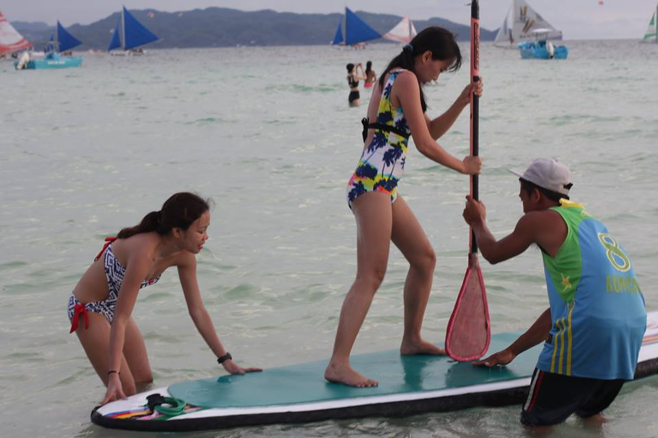 stand-up paddle in an open beach is not easy