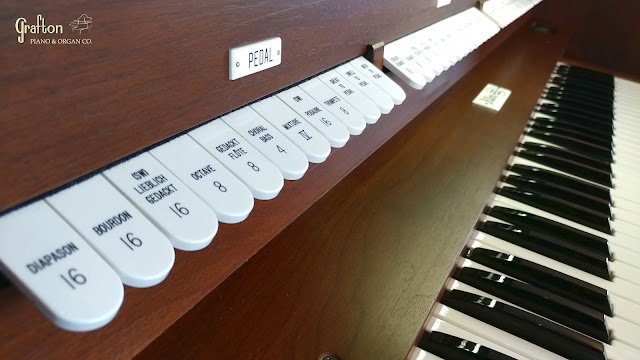 view of pedal and swell division stop tabs on Allen organ