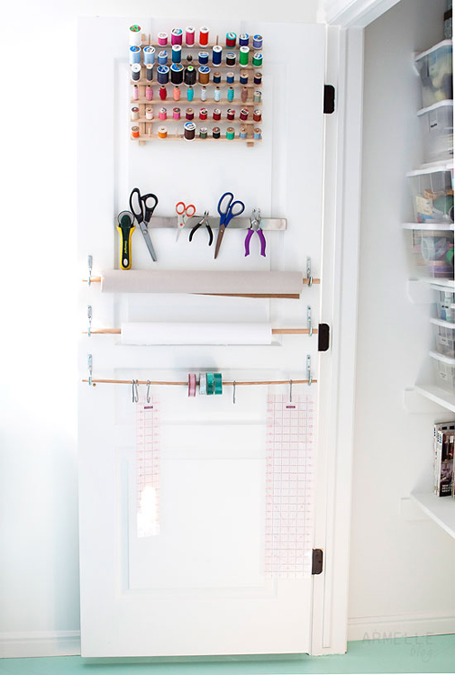 closet+door+hanging+storage+space+for+scissors+threads+and+paper+rolls Craft Room Storage and Organization from Armelle Studio