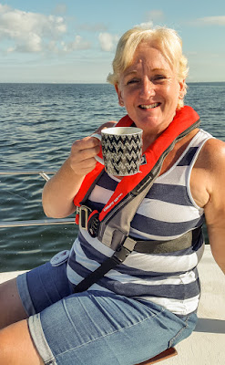Photo of me enjoying a cup of tea at sea
