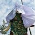 Patung Dewa Disebuah Kelenteng Harus Ditutup Kain Putih Karena Alasan IMB
