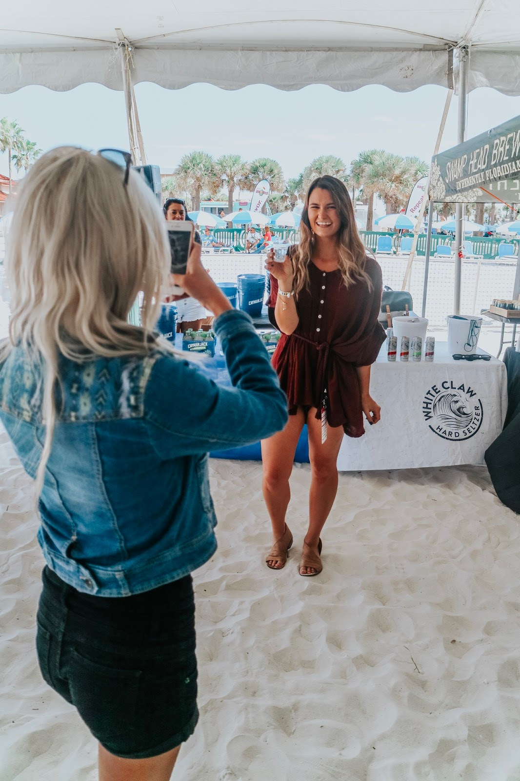 Tampa Bay Blogger at Clearwater Beach's Uncorked food and wine festival posing with White Claw