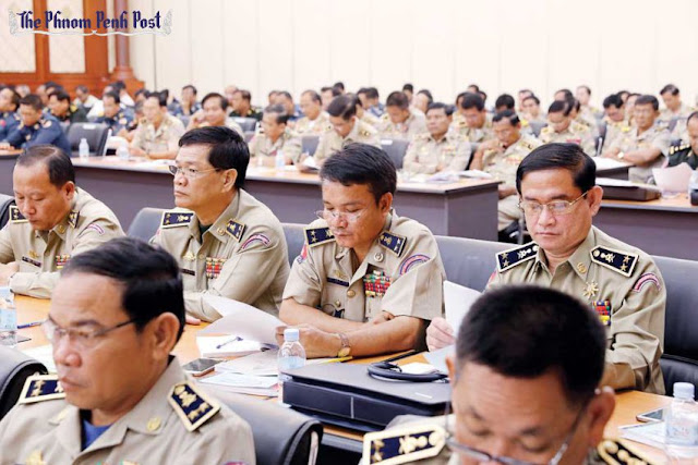 Ministry of Interior officials attend a meeting in Phnom Penh on security for voter registration and upcoming elections yesterday. Pha Lina