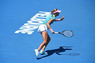 Kristina Mladenovic in Blue Dress while Practicing in Melbourne