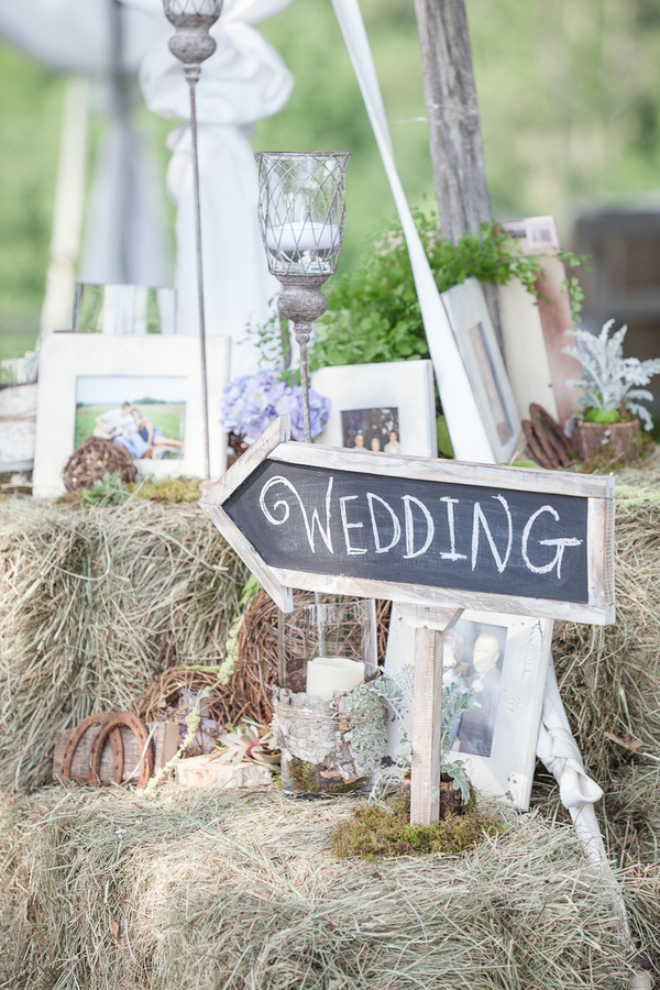 rustic+wedding+shabby+chic+summer+spring+burlap+moss+green+purple+violet+lavender+mint+emerald+outdoor+horse+cowboy+centerpiece+cake+table+dessert+candy+buffet+1326+studios+21 - Rustic Springtime