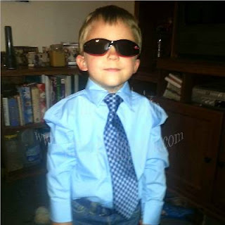 Our Grandson wearing sunglasses and a tie.