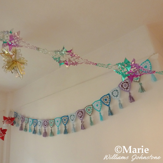 Tassels Crochet garland in winter shades of blue and lilac see the craft pattern and tutorial at craftymarie