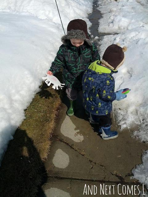 Kids walking outdoors, splashing in puddles