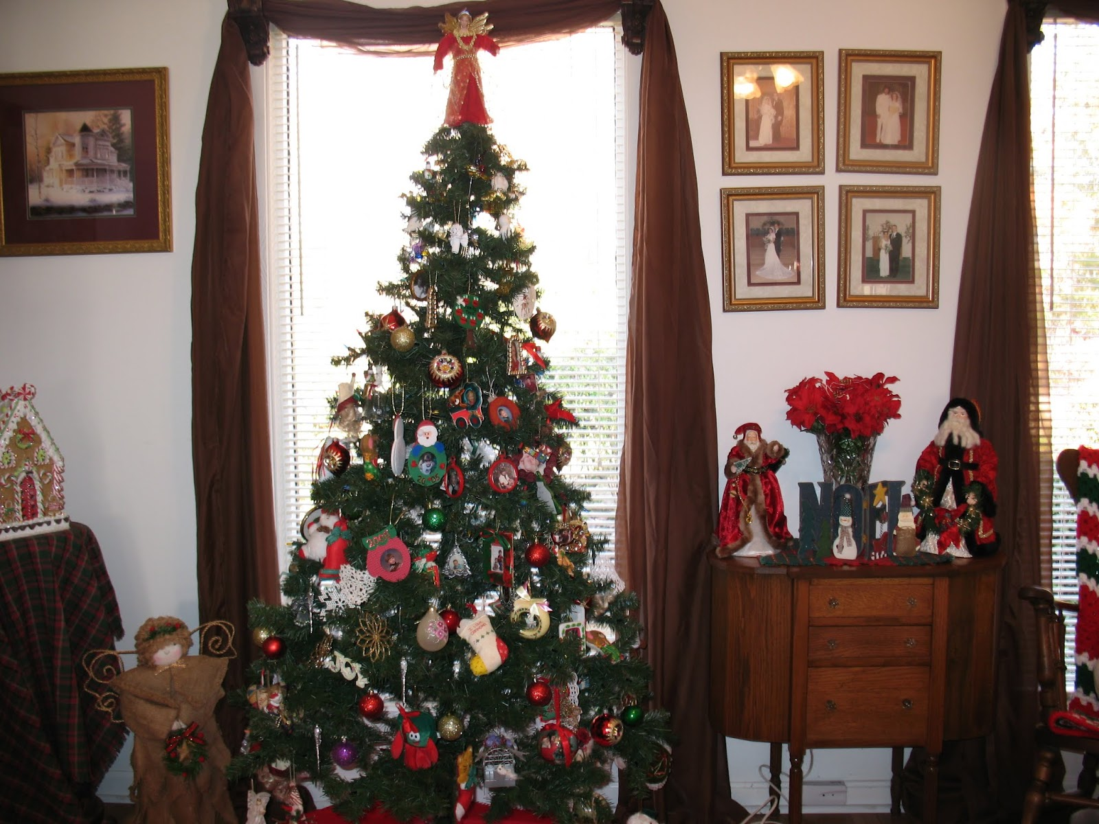 This Six Foot Green Tree With Colored Lights And Ornaments With My Grandchildren And Great Grandchildren Pictures And Ornaments That Have Been Given To Me