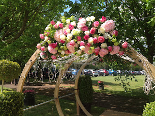 Pink wedding flowers outdoors