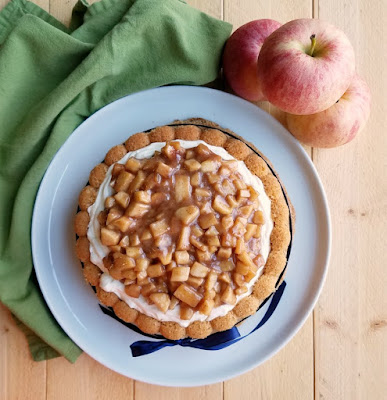 looking down on whole cinnamon sponge charlotte cake with caramel apples