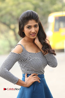 Telugu Actress Roshini Prakash Stills Short Dress at Saptagiri Express Release Press Meet  0049.JPG