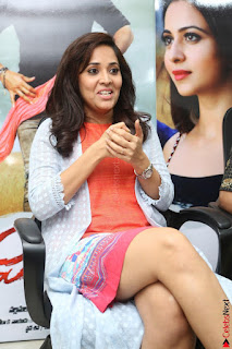 Actress Anasuya Bharadwaj in Orange Short Dress Glam Pics at Winner Movie Press Meet February 2017 (19).JPG