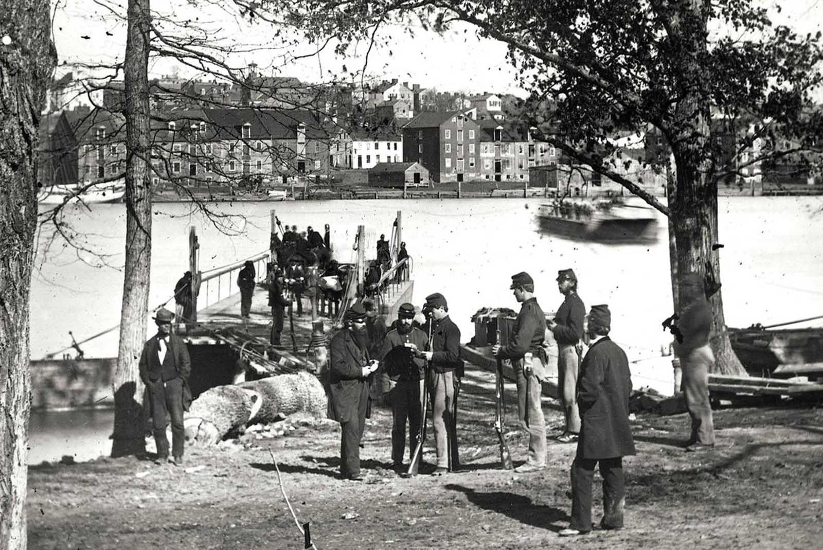 Guards examine passes near Georgetown, Washington District of Columbia, on the banks of the Potomac River, during the Civil War in 1865.