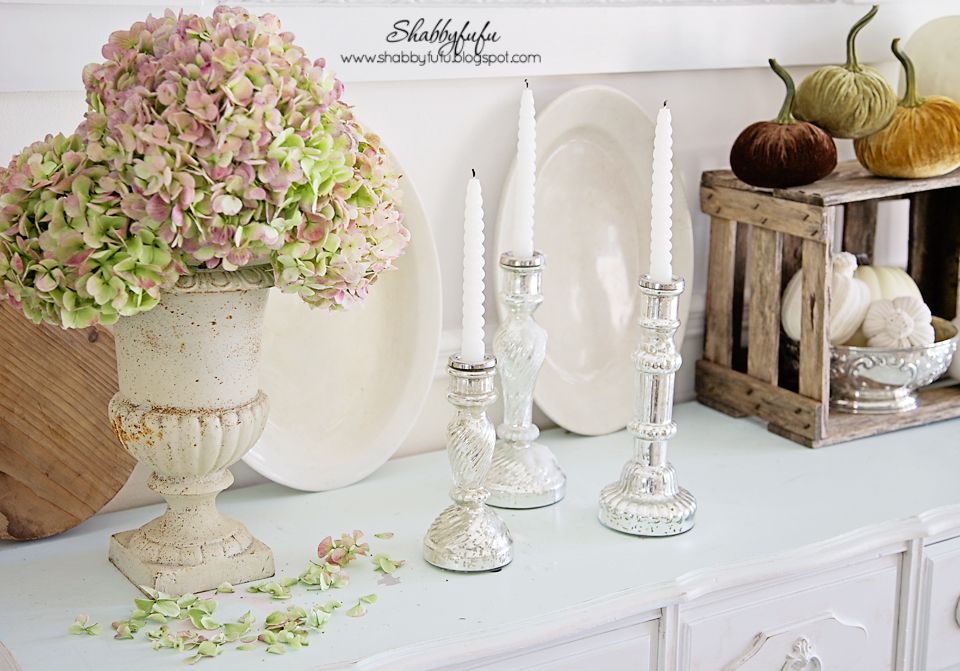 Add some vintage candle holders and fresh flower displays to bring some life into your fall vignettes in your home.