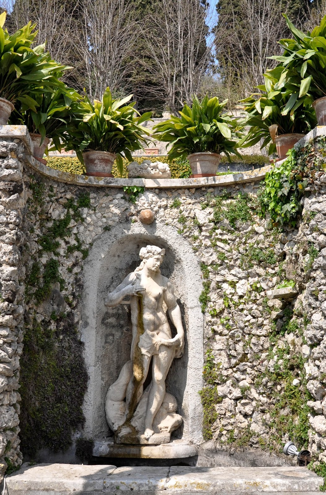 The small fountain in the park of Villa da Schio, Costozza is adorned by a statue of a Goddess of the Sea