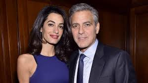 George Clooney vows to sue French magazine over twins' photos