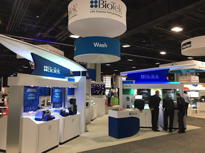 Customers at BioTek booth at the SLAS