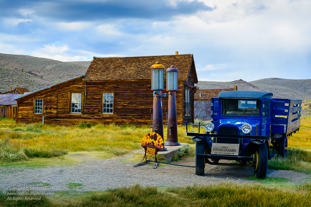 a photo of a truck and filling station in the bodie ghost town