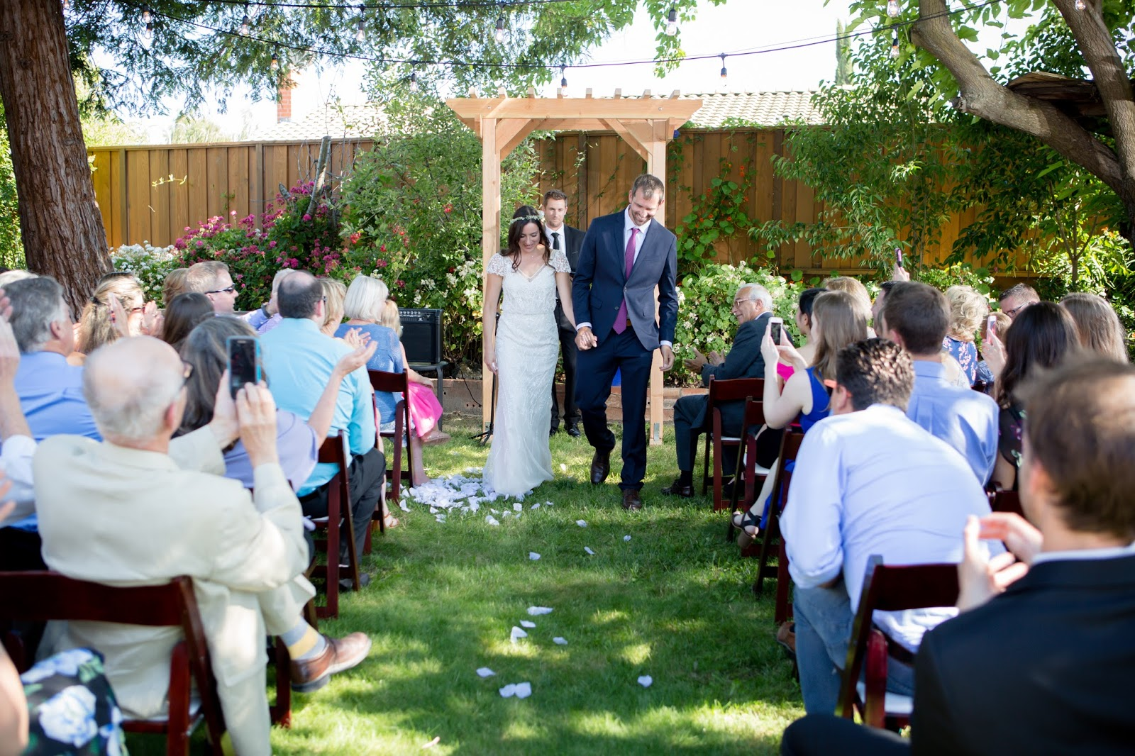 walking down the isle after vows backyard wedding