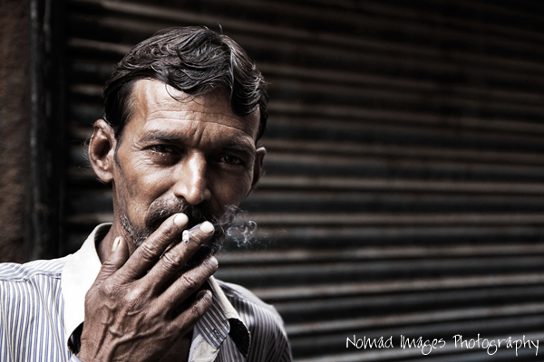portrait photo of indian guy smoking
